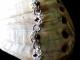 Half Romanov sterling silver, tantalum, and freshwater pearl bracelet.