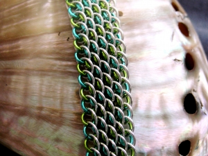 Sterling silver and aqua and lime green enameled copper Dragonscale bias bracele