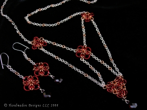 Sterling silver, copper, enameled copper, and Garnet Celtic Revival style set